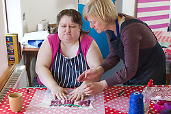 Felt making class for people with a visual impairment - rubbing the raw wool.