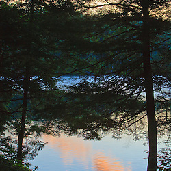 A canoe on the shore next to Zack Woods Pond in Hyde Park, Vermont. Early morning. Green River Reservoir State Park