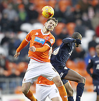 Blackpool's Andrea Orlandi jums with Millwall's Magaye Gueye<br /> <br /> Photographer Mick Walker/CameraSport<br /> <br /> Football - The Football League Sky Bet Championship - Blackpool v Millwall - Saturday 10th January 2015 - Bloomfield Road - Blackpool <br /> <br /> © CameraSport - 43 Linden Ave. Countesthorpe. Leicester. England. LE8 5PG - Tel: +44 (0) 116 277 4147 - admin@camerasport.com - www.camerasport.com