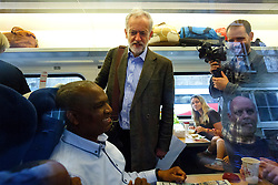 © Licensed to London News Pictures. 18/08/2015. London, UK. Labour Party leader candidate JEREMY CORBYN traveling to Middlesbrough via a Virgin train service after outlining his plans for integrated publicly owned railway network at King's Cross station in London on Tuesday, August 18, 2015. Photo credit: Tolga Akmen/LNP