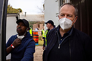 Bill Shorten (right) is seen preparing to unload a truck full of halal meat in the main staging area outside of the remaining locked down tower at Alfred Street as he helps deliver tons of meat to the residents during COVID-19 on 10 July, 2020 in Melbourne, Australia. Former Federal Labor Leader Bill Shorten, along with close allies at Trades Hall help deliver Halal meat, supplied by Macca Halal Foods to the locked down housing commission towers following a coronavirus outbreak detected inside the complex. Mr Shorten was able to use his high profile to ensure food was not turned away by police so that it would reach the residents inside. (Photo be Dave Hewison/ Speed Media)