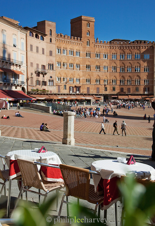 The Piazza del Campo has many bars and restaurants, and is popular with both tourists and locals in Siena, Tuscany, Italy