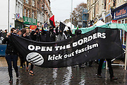 Black block join locals from Dover, Folkestone and Thanet today called a demonstration to welcome refugees into the UK via Dover. Organised by Kent anti racism network. Dover, Kent.
