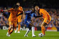Photo: Daniel Hambury.<br /> Chelsea v Barcelona. UEFA Champions League, Group A. 18/10/2006.<br /> Chelsea's Claude Makelele gets between Barcelona's Lionel Messi (L) and Eidur Gudjohhnsen.