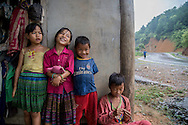 Young children poses along the road to Bac Ha, Vietnam, Southeast Asia