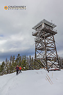 Cross country ski touring by Firefighter Mountain Lookout Tower in the Flathead National Forest, Montana, USA MR