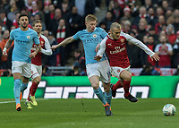 Football - 2018 Carabao (EFL/League) Cup Final - Manchester City vs. Arsenal<br /> <br /> Kevin De Bruyne (Manchester City) edges Jack Wilshere (Arsenal FC) off the ball as they race to it at Wembley.<br /> <br /> COLORSPORT/DANIEL BEARHAM
