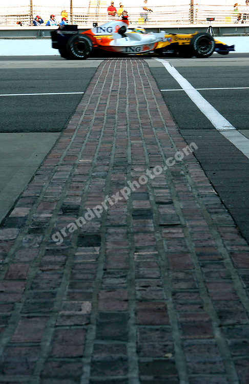 Giancarlo Fisichella (Renault) passes the start/finish line made of the original bricks during qualifying for the 2007 United States Grand Prix in Indianapolis. Photo: Grand Prix Photo