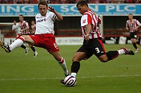 Photo: Tony Oudot.<br /> Brentford v Lincoln City. Coca Cola League 2. 27/10/2007.<br /> Lewis Emanuel of Brentford clears from Scott Kerr of Lincoln