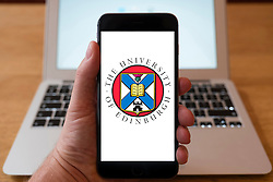 Using iPhone smartphone to display logo of the University of Edinburgh in Scotland, UK