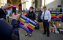 © Licensed to London News Pictures.15/03/2017.London, UK.  Supporters of Sergeant Alexander Blackman, pose for a photograph while waiting outside the Royal Courts of Justice in London, before a judge reduced the conviction of Sgt Blackman from Murder to Manslaughter, on appeal.  Also known as Marine A, Sgt Blackman was appealing a life sentence for the murder of a wounded Taliban fighter in Afghanistan in 2011.Photo credit: Ben Cawthra/LNP