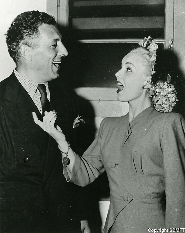 1944 Ezio Pinza and Janet Blair sing together at the Hollywood Canteen