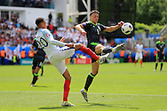 Dele Alli of England (l) challenges James Chester of Wales. UEFA Euro 2016, group B , England v Wales at Stade Bollaert -Delelis  in Lens, France on Thursday 16th June 2016, pic by  Andrew Orchard, Andrew Orchard sports photography.
