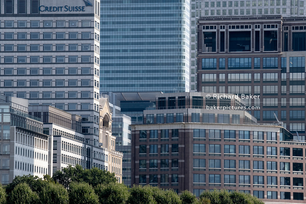 Corporate high-rise offices including the Credit Suisse building at Canary Wharf in London Docklands, on 16th September 2021, in London, England. Canary Wharf was once a thriving Victorian cargo dock but after Thames shipping declined from the 1960s, its derelict areas were redeveloped in the 19080 by Margaret Thatcher's Docklands Development Corporation created one of the UK's main financial centres, now home to the European Headquarters of numerous major banks including Barclays, Credit Suisse and HSBC.