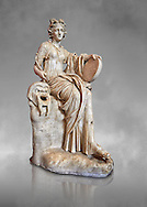 2nd century AD Roman statue of the muse of comedy, Thalia, with a tympanum and a comic mask. A Roman copy of a 4th century BCHellenistic statue, inv 295, Vatican Museum Rome, Italy,  grey art background ..<br /> <br /> If you prefer to buy from our ALAMY STOCK LIBRARY page at https://www.alamy.com/portfolio/paul-williams-funkystock/greco-roman-sculptures.html . Type -    Vatican    - into LOWER SEARCH WITHIN GALLERY box - Refine search by adding a subject, place, background colour, museum etc.<br /> <br /> Visit our CLASSICAL WORLD HISTORIC SITES PHOTO COLLECTIONS for more photos to download or buy as wall art prints https://funkystock.photoshelter.com/gallery-collection/The-Romans-Art-Artefacts-Antiquities-Historic-Sites-Pictures-Images/C0000r2uLJJo9_s0c