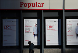 June 5, 2017 - Madrid, Spain - A  man walks past in front of branch of Popular Bank in Madrid..Shares in Banco Popular Español SA POP plunged 18.2% due to Spanish bank may not find a buyer and have to be wound down. (Credit Image: © Jorge Sanz/Pacific Press via ZUMA Wire)