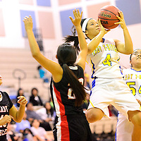 011514  Adron Gardner/Independent<br /> <br /> Zuni Thunderbird Tamika Thompson (4) rises for a field goal over the Crownpoint Eagles in Zuni Wednesday.