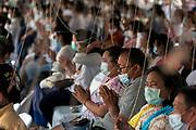 Freshly cast buddha statues are poured at a ceremony at Wat Thiphawad, Ladkrabang, near Bangkok