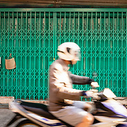 Blurred motion of motorbike rider in Thon Buri neighbourhood of Bangkok
