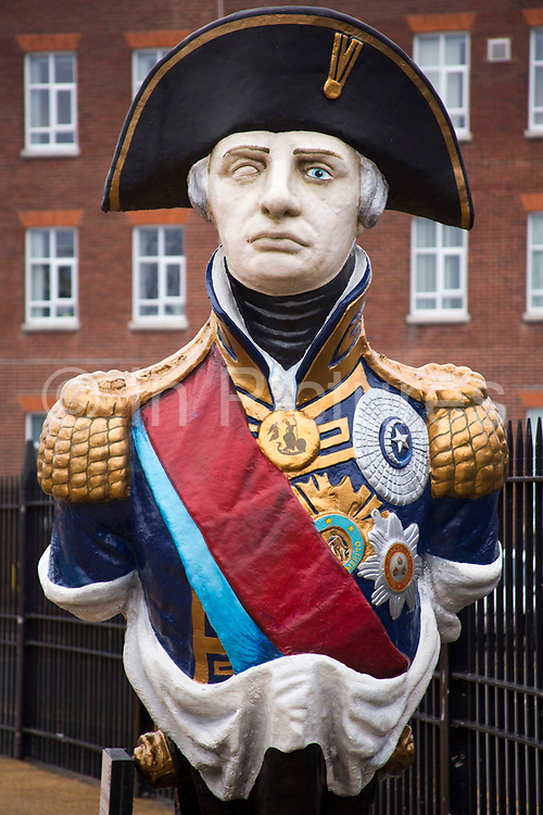 Admiral Lord Horatio Nelson figure head.  Standing at about 9ft (2.7m), the wooden bust which once adorned the bows of HMS Trafalgar is on show alongside HMS Victory in Portsmouth's dockyard.