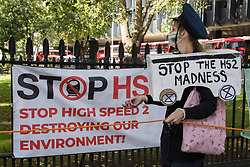Activists from HS2 Rebellion, an umbrella campaign group comprising longstanding campaigners against the HS2 high-speed rail link as well as Extinction Rebellion activists, march with the handmade Boris the Bank Engine to a protest rally in Parliament Square on 4 September 2020 in London, United Kingdom. The rally, and a later protest action at the Department of Transport during which activists glued themselves to the doors and pavement outside and sprayed fake blood around the entrance, coincided with an announcement by HS2 Ltd that construction of the controversial £106bn high-speed rail link will now commence.