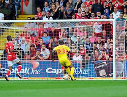 Milton Keynes Dons' Benik Afobe scores an open goal after a mistake from Bristol City's Wade Elliott  - Photo mandatory by-line: Joe Meredith/JMP - Mobile: 07966 386802 - 27/09/2014 - SPORT - Football - Bristol - Ashton Gate - Bristol City v MK Dons - Sky Bet League One