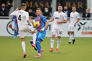 Cove Rangers' Connor Scully (4) and Inverness Caledonian Thistle's Shane Sutherland (11) battles for possession, tussles, tackles, challenges, during the Premier Sports Scottish League Cup match between Cove Rangers and Inverness CT at Balmoral Stadium, Aberdeen, Scotland on 20 July 2021.