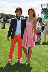 LADY VICTORIA HERVEY and ANDY WONG at the 27th annual Cartier International Polo Day featuring the 100th Coronation Cup between England and Brazil held at Guards Polo Club, Windsor Great Park, Berkshire on 24th July 2011.