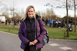 18 November 2020. Care4Calais - Calais, France.<br /> Claire Moseley, founder of the migrant charity Care4Calais stands at a food and services distribution point helping migrants in Calais. Her charity provides meals, clothing, haircuts, charging stations for phones, hot drinks, tents, blankets and a wide range of goods and services to help migrants struggling to survive on the streets of Calais where they are continually harassed and moved on by authorities. <br /> Photo©; Charlie Varley/varleypix.com