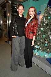 Left to right, MARIA GRACHVOGEL and OLIVIA GRANT at the official opening of the 2014 Tiffany & Co.Christmas Shop on Bond Street, London on 16th November 2014.