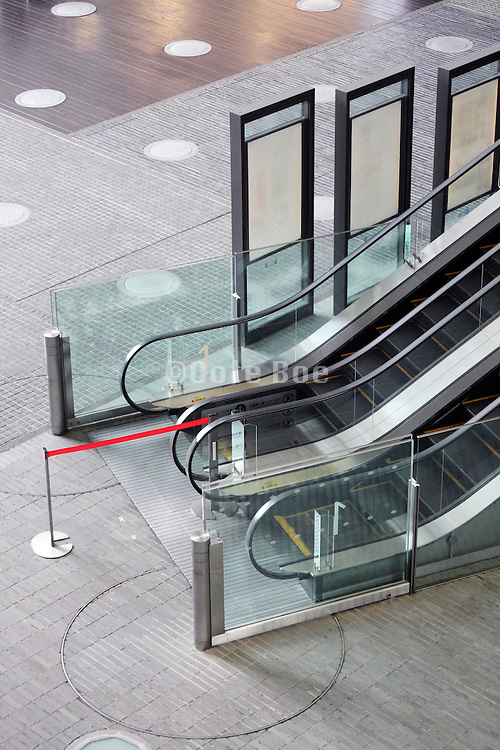 empty public space with escalator in large office building
