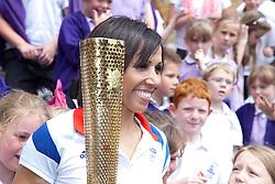 © London News Pictures. 17/07/2012. Tonbridge Castle, Tonbridge, Kent. Dame Kelly Holmes holds the unlit Olympic Torch in the gardens of Tonbridge Castle, Kent.  Photo credit should read Manu Paomeque/LNP.