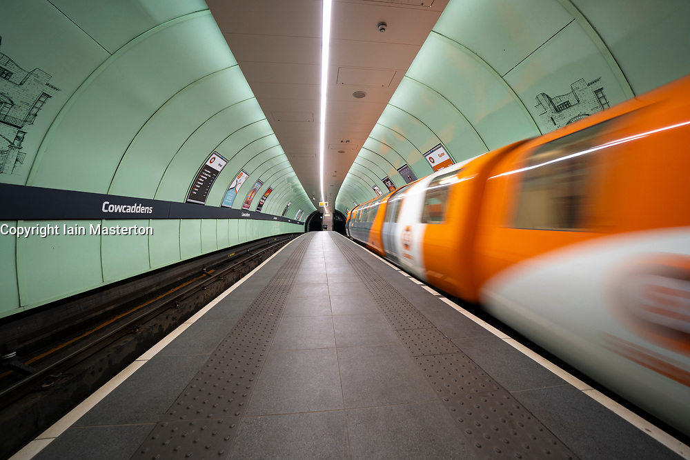 Glasgow, Scotland, UK. 1 April, 2020. Effects of Coronavirus lockdown on streets of Glasgow, Scotland. Empty platform as train on Glasgow Subway leaves station. Iain Masterton/Alamy Live News