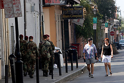 30 Sept, 2005.  New Orleans, Louisiana. Hurricane Katrina aftermath. <br /> Locals pass members of the 82nd Airbourne regiment as they patrol on foot in the French Quarter.<br /> Photo; ©Charlie Varley/varleypix.com