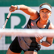 PARIS, FRANCE May 30. Naomi Osaka of Japan during her match against Patricia Maria Tig of Romania in the first round of the Women's Singles competition on Court Philippe-Chatrier at the 2021 French Open Tennis Tournament at Roland Garros on May 30th 2021 in Paris, France. (Photo by Tim Clayton/Corbis via Getty Images)