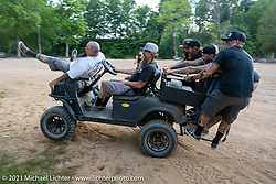 Jeff Holt holds on as Pat Patterson pilots skillfully drives a side-by-side at the Tennessee Motorcycles and Music Revival at Loretta Lynn's Ranch. Hurricane Mills, TN, USA. Saturday, May 22, 2021. Photography ©2021 Michael Lichter.
