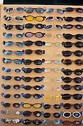 wall display of multiple sunglasses