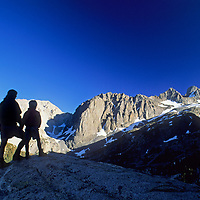 A mother and her son stand atop a granite dome in Big Pine Canyon in California's Sierra Nevada.  Behind them is the Palisade Glacier (R) and (L to R) Slide Mountain, Temple Crag, Mount Gayley, Mount Sill & North Palisade.