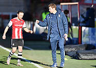 Exeter City manager, Matt Taylor fist bump with Matt Jay (17) of Exeter City after full time of the EFL Sky Bet League 2 match between Exeter City and Stevenage at St James' Park, Exeter, England on 23 January 2021.