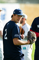 KELOWNA, CANADA - JUNE 28: NHL player Luke Schenn stands in the dugout during the opening charity game of the Home Base Slo-Pitch Tournament fundraiser for the Kelowna General Hospital Foundation JoeAnna's House on June 28, 2019 at Elk's Stadium in Kelowna, British Columbia, Canada.  (Photo by Marissa Baecker/Shoot the Breeze)
