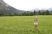 A girl frolics in the Bavarian Fields of Germany.
