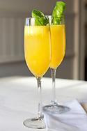 """Peach and basil non-alcoholic """"bellini"""" in glassware."""