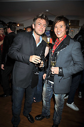Left to right, ERIC RUSSELL and ANDY WONG at a party to celebrate the opening of Barts, Sloane Ave, London on 26th February 2009.