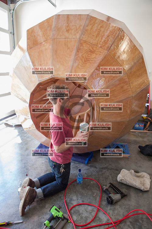 Scenes of daily work and life at Facebook', Inc. USA Headquarters in Menlo Park, California.  A Facebook employee works in the wood shop on campus
