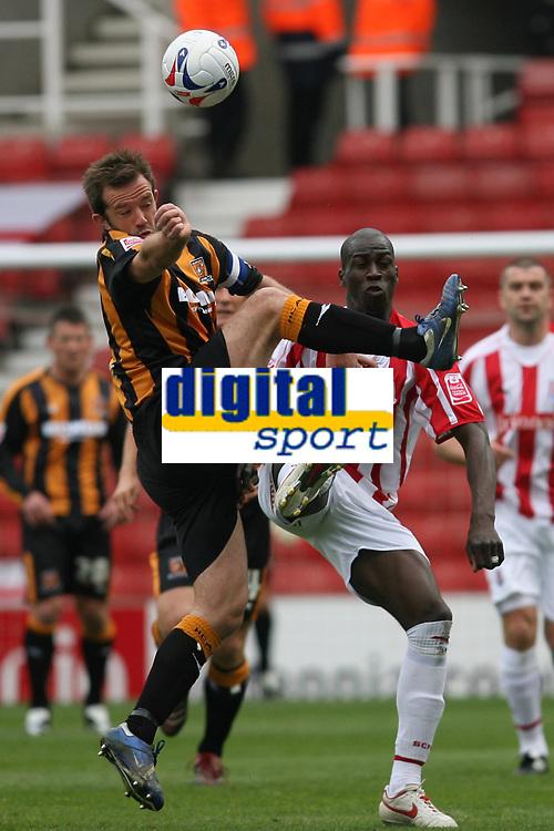 Photo: Pete Lorence.<br />Stoke City v Hull City. Coca Cola Championship. 21/04/2007.<br />Ian Ashby and Mamady Sidibe battle for the ball.
