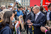 SPD Chancellor candidate and current German Finance Minister Olaf Scholz speaks to speaks with Afghan refugees following an election campaign event of the German Social Democratic Party (SPD) at Bebelplatz square In Berlin, Germany, August 27, 2021. Scholz spoke with the group who was demonstrating peacefully outside his campaign event for several minutes, mainly answering their questions about intervention in the situation in Afghanistan and help to relatives who are stranded there. Germany's federal elections are due to take place on September 26, 2021.