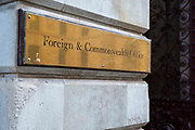 The Foreign and Commonwealth Office brass plaque sign outside the building on the 11th of February 2020 in Westminster, London, United Kingdom.
