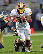 Washington Redskins running back Clinton Portis brakes through a open hole against St. Louis in the secon half, at the Edward Jones Dome in St. Louis, Missouri, December 4, 2005.  The Redskins beat the Rams 24-9.