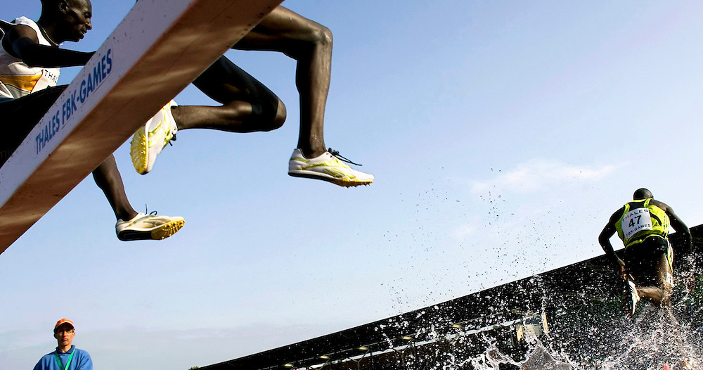 The Netherlands, Hengelo, 26-05-2007.<br /> Athletics.<br /> The Fanny Blankers-Koen Games.<br /> 3000 metres steeple chase, Men.<br /> The competitors are crossing the barrier and the water pits. Michael Kipyego from Kenya (number 41 ).<br /> Photo: Klaas Jan van der Weij