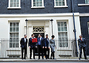 © Licensed to London News Pictures. 21/03/2012. Westminster, UK. George Osborne's staff leave him on Downing Street to pose for photographs. British Chancellor of the Exchequer George Osborne holds his red ministerial box as he poses for pictures outside 11 Downing Street in London, on March 21, 2012. The Chancellor is expected to raise the amount of money people can earn before income tax takes hold and impose a new levy on the purchase of expensive homes. Photo credit : Stephen SImpson/LNP